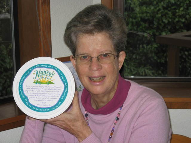 "Laura with trusty  Nancy's Yogurt containing ""billions of live cultures""."