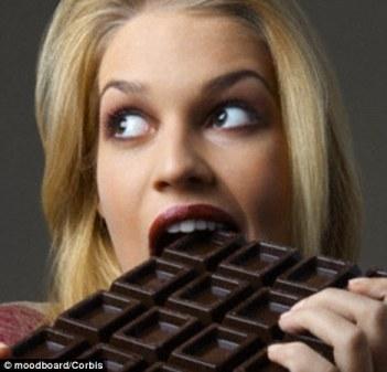 woman eating choc bar